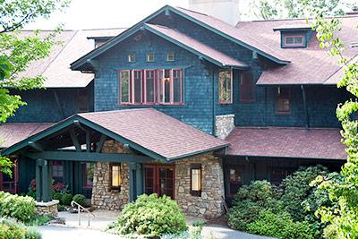 The stone and cedar exterior of the Sourwood Inn