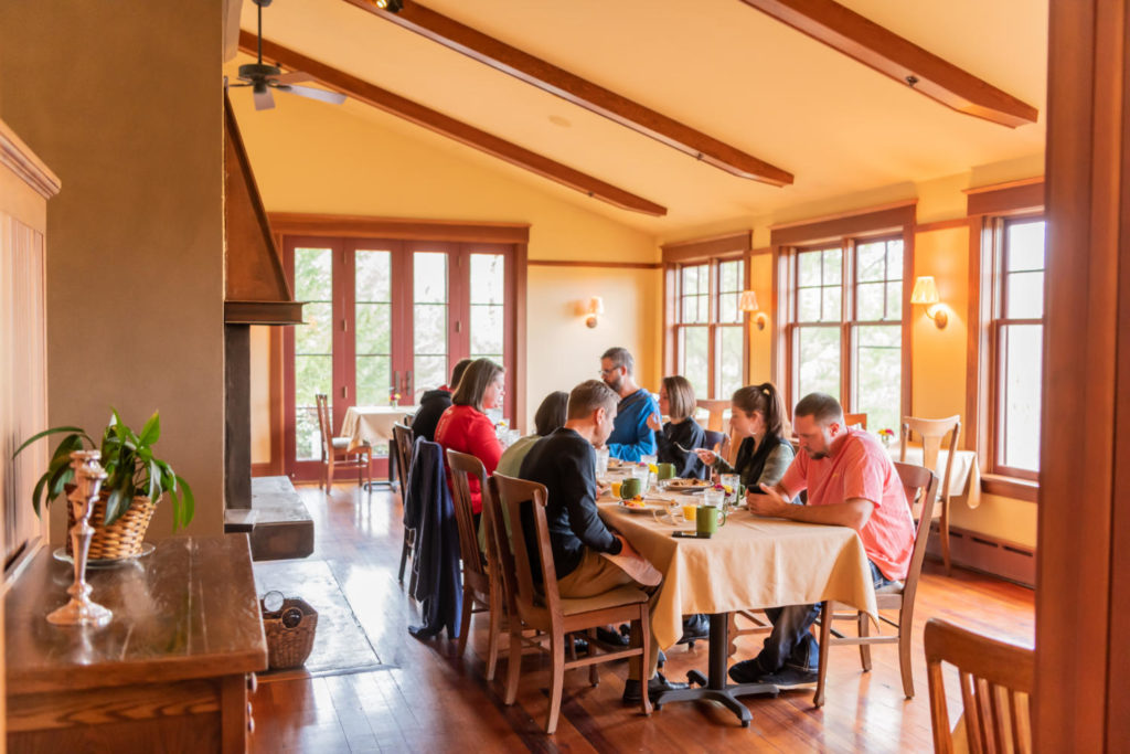 Church group gathering in the dining room for a retreat