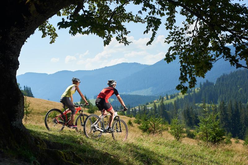 Couple biking in the mountains