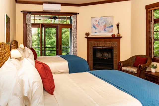 Two queen beds with fireplace